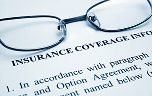 Reading glasses on top of insurance coverage info document