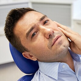 man in dental chair having toothache