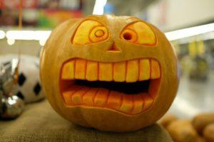 Halloween pumpkin carved with big teeth
